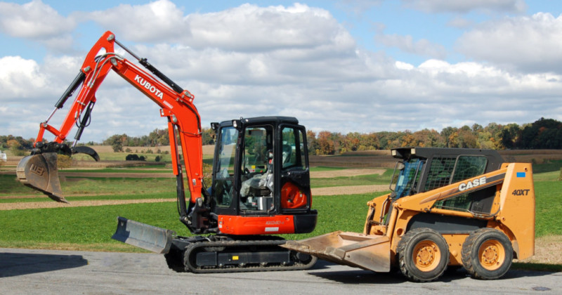 "Case 40XT skid steer loader with bucket options for dirt and material handling. Kubota KX040 mini excavator w/ 12"", 16"", 24"" buckets, a hydraulic thumb, and a hydraulic compactor."